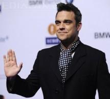 SHOWBIZ / Robbie Williams a lansat prima sa linie vestimentară, colecţia Farrell